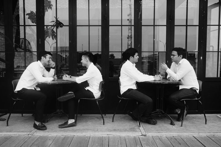 Discussions Coffee Discussion Friendship Laughing Blackandwhite EyeEm Selects Full Length Sitting Musician Actor Arts Culture And Entertainment Business Meeting Friend