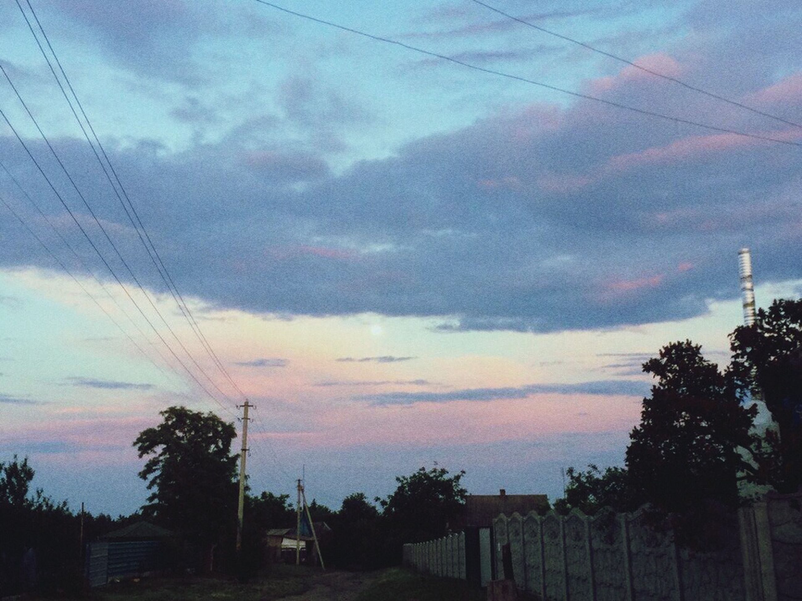 sky, power line, cloud - sky, sunset, tree, electricity pylon, silhouette, cable, cloudy, electricity, cloud, power supply, low angle view, connection, built structure, scenics, beauty in nature, dusk, tranquility, nature