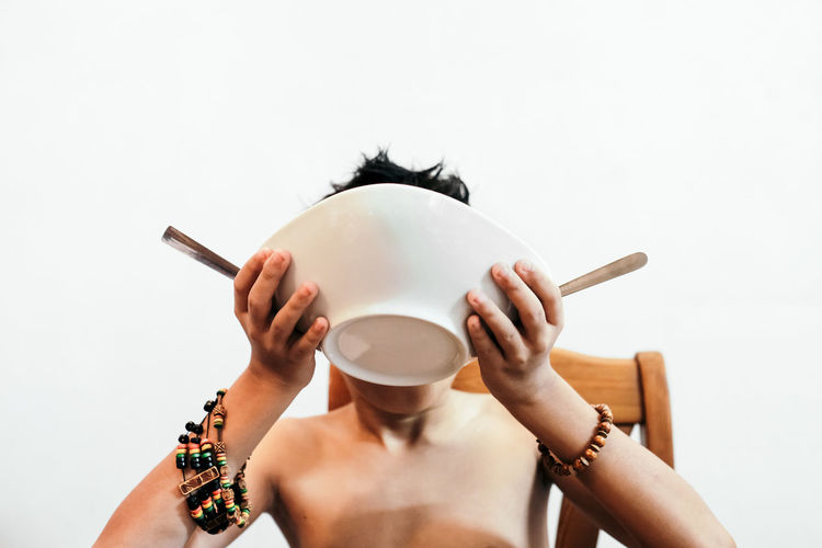 Irresistable Maggi Noodles 🍜 At Home Fantastic Meal Food And Drink This Is Queer Bracelet ♥ Conceptual Enjoying The Food Food For All Headshot Holding Leisure Activity Lifestyles Obscured Face Shirtless Slurp Soup Topless, White Background Visual Creativity