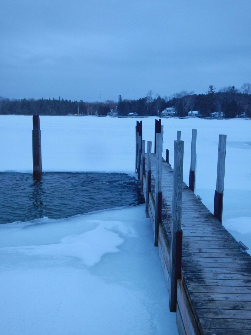 water, nature, sea, cold temperature, tranquility, scenics, tranquil scene, beauty in nature, winter, outdoors, snow, day, sky, no people, wooden post, horizon over water, tree