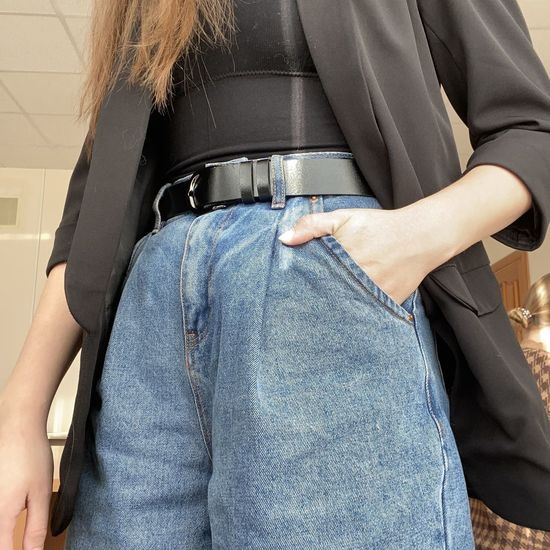 Midsection of woman standing with hand in pocket