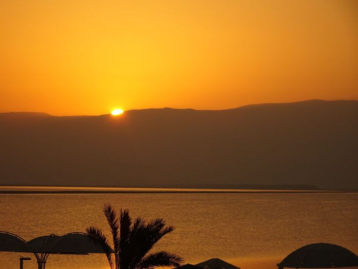 Dawn Sunrise over the Dead Sea  in Israel facing the Jordan mountains, part of the Great Rift This is the lowest inhabited place on earth, being 429m below sea level. And it is hot! Seeing The Sights 43 Golden Moments Colour Of Life