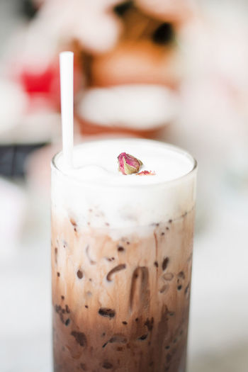 Closed up Iced chocolate with milk foam on top with straw in bokeh background Cafe Coffee Caffeine Bright Cup Serve Drinks White Whip Cream Cold Cool Glass Milk Chocolate Foam Beverage Bokeh Breakfast Brown Cocoa Drink Delicious Diet Drink Fresh Healthy Ice Restaurant Straw Sugar Summer Sweet Table Tasty