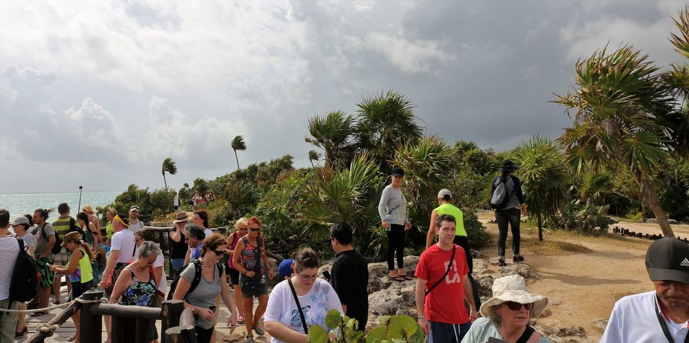 Tourist Crowd at Tulum Ruins Adult Behind The Scenes Cloud - Sky Crowd Crowd Of People Crowded Place Crowds Day Large Group Of People Men Nature Outdoors Palm Tree People Real People Sky That's The Way It Is Togetherness Tourist Attraction  Tourist Destination Tourist Spot Tourists Tree Truth Women