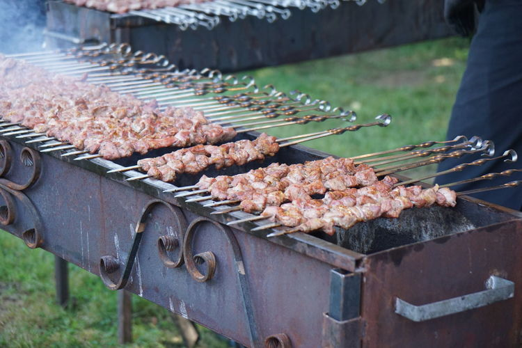 Close-up of kebabs in skewers on barbecue grill