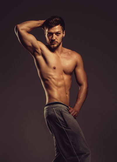 Athletic young man posing, studio shot Athlete Athletic Bodybuilding Abdominal Abs Attractive Beauty Biceps Caucasian Fitness Fitness Model Handsome Men Muscular Build One Person Physique  Pose Posing Sport Sportive Strength Strong Studio Shot Training Young Adult