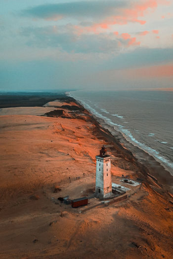 High angle view of lighthouse at beach