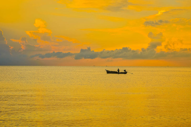 New Day At Samila Beach Songkhla Thailand Beauty In Nature Cloud - Sky Fishing Boat Horizon Horizon Over Water Mode Of Transportation Nature Nautical Vessel No People Orange Color Outdoors Scenics - Nature Sea Silhouette Sky Sunset Tranquil Scene Tranquility Transportation Water Waterfront