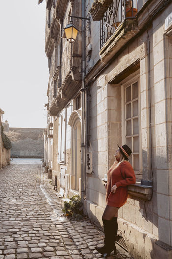 Woman standing in city