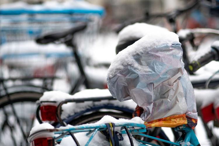 Close-up of bicycle on garbage