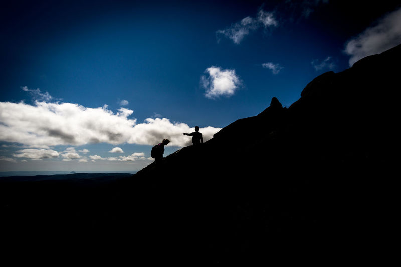 Black And Sky Blue Sky Goatfell  Hiking People Pointing Scotland Shadow