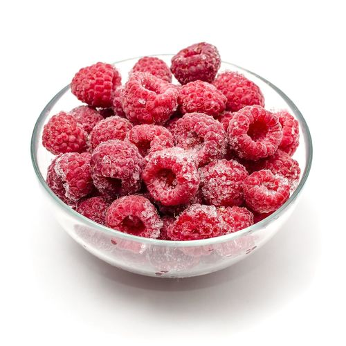 Close-Up Of Served Raspberries In Bowl