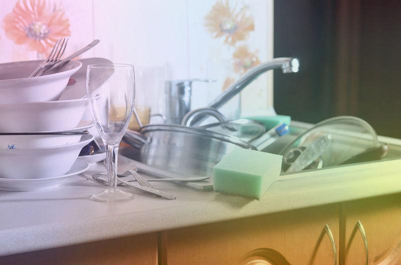 Kitchen utensils in sink at home