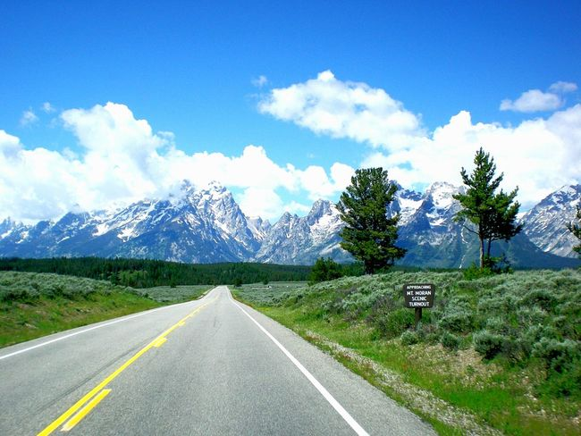 Grand Teton National Park  Roadandscenery Roadscenes Mountain Range Non-urban Scene Serene Outdoors Field Meadows Cloud - Sky Mountain Peak Mountain View Serene Tranquil Outdoors The Way Forward Road Transportation Road Marking Landscape Diminishing Perspective Tranquil Scene Vanishing Point Empty Long Sky Tranquility Solitude The Traveler - 2018 EyeEm Awards The Great Outdoors - 2018 EyeEm Awards