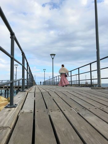 Wooden Wharf Pier Art Beauty Clouds Shapes Lines Walking Woman Sky Cloud - Sky Nature Day Built Structure Architecture Railing Real People Transportation Metal Track Railroad Track The Way Forward Connection Security Outdoors Direction Beach Pier Surface Level