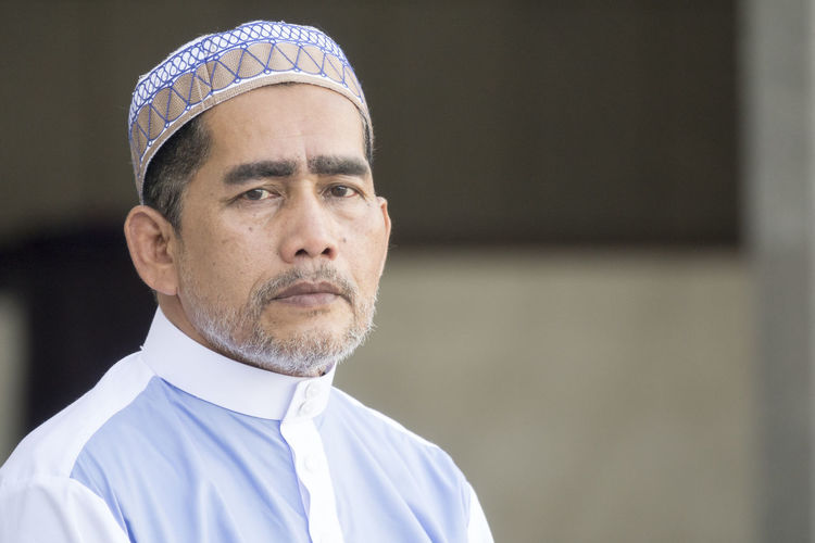 Close-Up Portrait Of Man Standing At Mosque