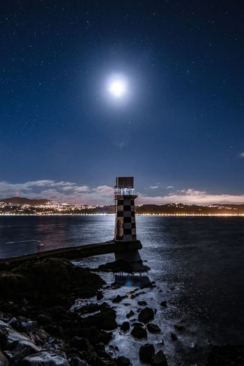 Architecture Astronomy Beauty In Nature Built Structure Full Moon Land Moon Moonlight Nature Night No People Outdoors Scenics - Nature Sea Sky Space Star - Space Tranquil Scene Tranquility Water