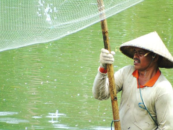 Fisherman in batu tulis lombok indonesia Waist Up Rain Water Wet One Person Front View Adults Only Outdoors One Man Only Day People Adult Only Men Fishing Leisure Activity Beauty In Nature Fisherman Trip MyWork MySelf