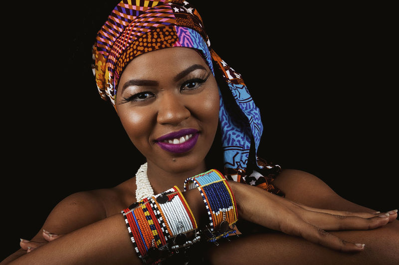 African Woman  African Lady Black Woman My Best Photo African Fabric Accessories African Accessories Bracelet Nails Headwrap  Skin Care Portrait Black Background Looking At Camera One Person Studio Shot Young Adult Young Women Front View Headshot Jewelry Indoors  Women Smiling Adult Necklace Lifestyles Fashion Beautiful Woman