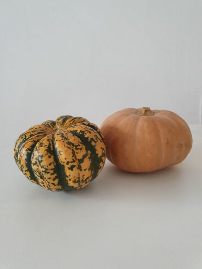 Close-up of pumpkins against white background