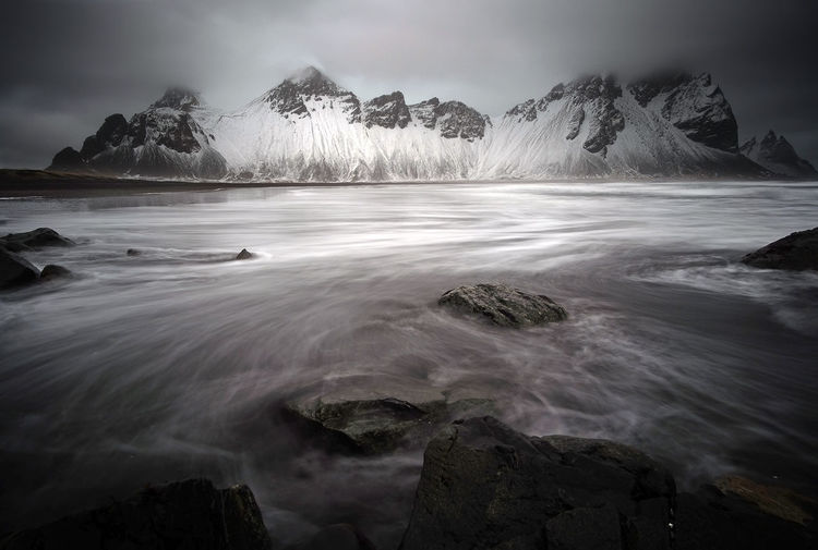 Vestrahorn before the storm, Iceland. 1/2 EyeEm Best Shots EyeEm Nature Lover EyeEmNewHere Iceland Landscape_Collection Storm The Great Outdoors - 2018 EyeEm Awards Beauty In Nature Clouds Iceland_collection Landscape Long Exposure Mountain Nature No People Outdoors Rock Scenics - Nature Sea Sky Storm Cloud Vestrahorn Water Winter
