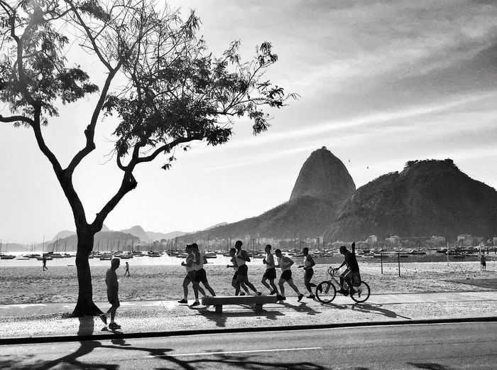 Real People Nature Men Mountain Tree Leisure Activity Beach Lifestyles Outdoors Sky Sand Embrace Urban Life Sea Beauty In Nature Vacations Morning Light And Shadow Blackandwhite Black And White Streetphotography Street Photography Jogging Running Rio De Janeiro Brasil