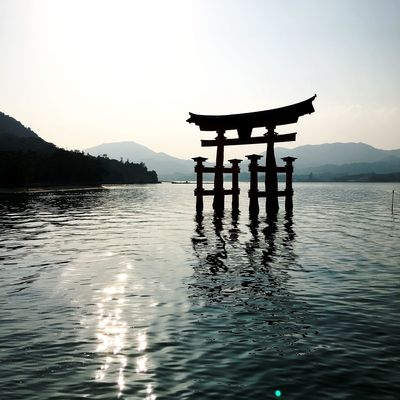 Miyajima Torii Gate Beauty In Nature Belief Clear Sky Japan Travel Lake Mountain Mountain Range Nature No People Outdoors Reflection Religion Scenics - Nature Shrine Silhouette Sky Spirituality Tranquil Scene Tranquility Water Waterfront