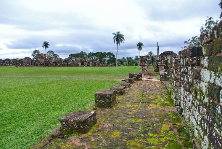 Ruins of Trinidad. Paraguay. Jesuit Mission Of La Santísima Trinidad De Paraná Palm Tree Christian Spanish Guarani Histroy  Abandoned Travel South America Paraná River Reduction UNESCO World Heritage Site Unesco World Heritage Nature Nature_collection Ruins Architecture Sightseeing Stone Jesuit Mission Jesuit Ruins Encarnacion Paraguay Trinidad Santisima Trinidad Tree Sky Grass Cloud - Sky
