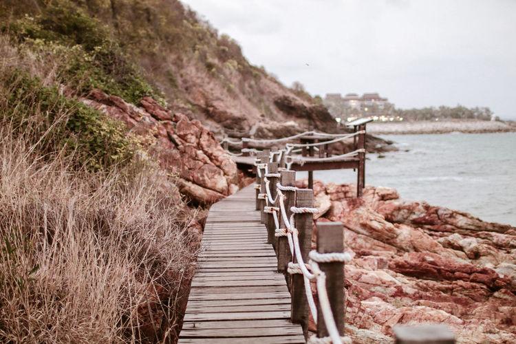 Empty boardwalk by sea