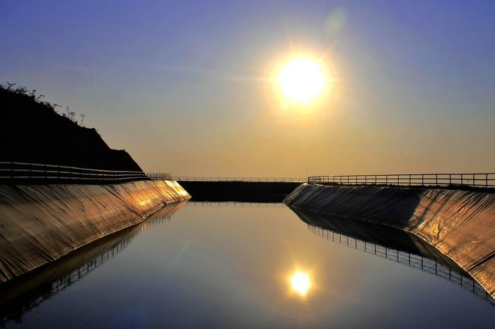 Reflection Water Sun Sky Sunset Sunlight Scenics Tranquility Lake Nature Outdoors Tranquil Scene Beauty In Nature No People Bridge - Man Made Structure Clear Sky Industry Day Astronomy Yogyakarta,indonesia. Sunrise. Reservoir.