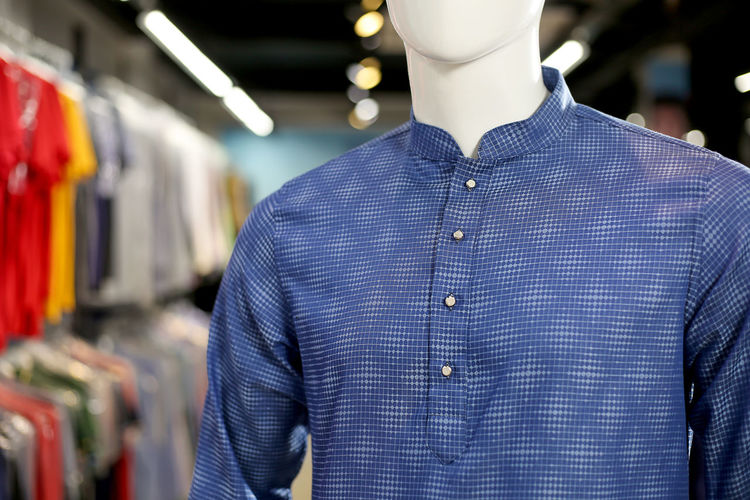 Close-up of kurta on mannequin for sale in store