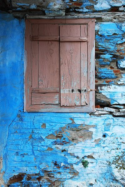 Blue Wall Brown Window Streetphotography Street Photography Windows And Walls Windows Cracked Wall Cracked Paint Blue Window Closed Window The Window The Window To Our Soul The Window To The Soul