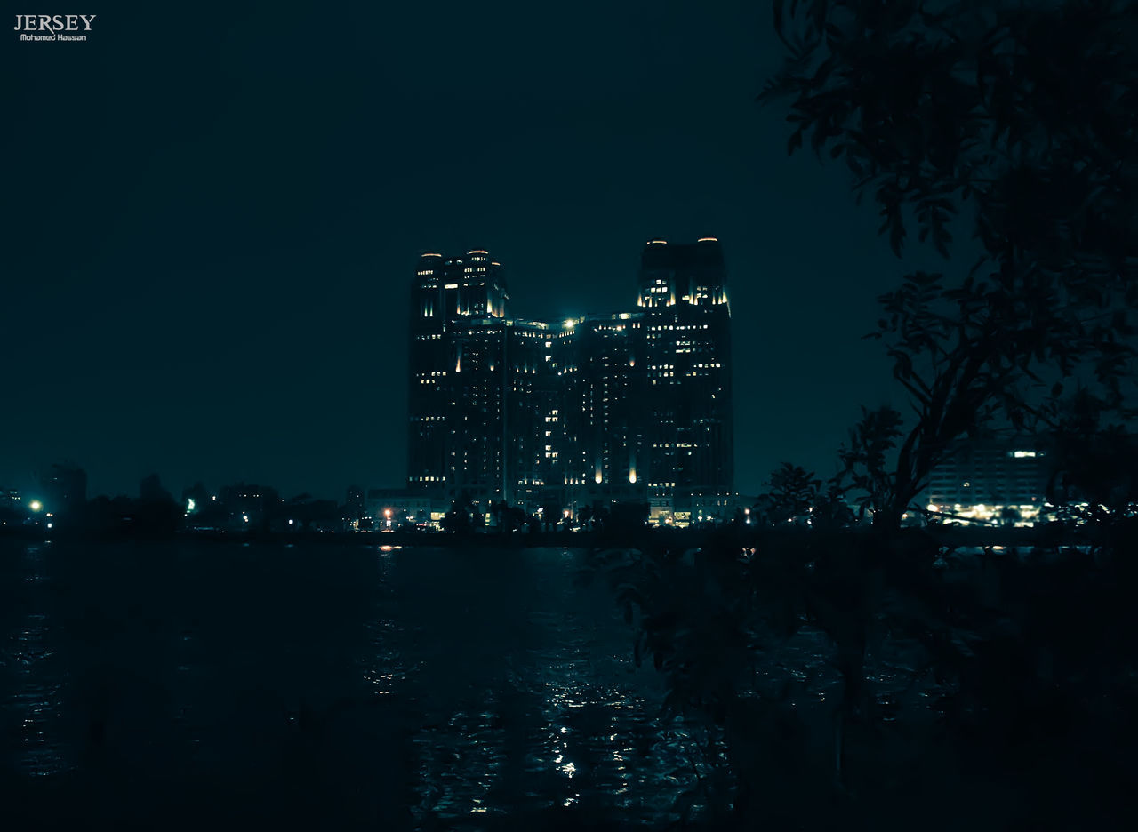 night, architecture, illuminated, built structure, building exterior, skyscraper, city, travel destinations, modern, no people, outdoors, water, cityscape, sky, tree, urban skyline, nature