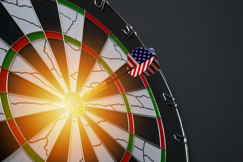 Center target of darts isolated on a black background Object Game Concept Circle Success Closeup Background Dart Dartboard Strategy Sport Board Marketing Target Business Center Winner Point Objective Arrow Bullseye Financial Targeting Symbol Perfect Mark Perfection Metaphor Targeted Planning Light Challenge Market Win Goals Achievement Aim Idea Score Hit Spot Audience Archery Number Play Accuracy Recreation  Leisure Competition No People Shape Pattern Flag Patriotism Geometric Shape Striped Multi Colored Low Angle View Design Studio Shot Indoors  Arts Culture And Entertainment Close-up Amusement Park Ride Illuminated National Icon