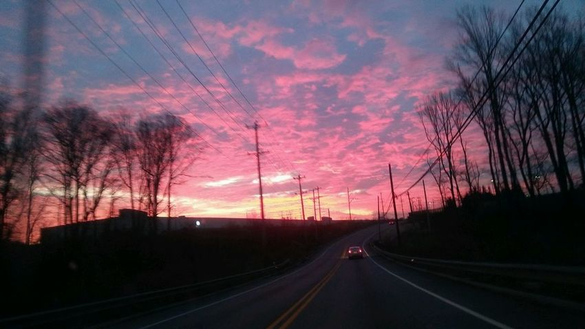 Sunrise Sunset Sky Road Tree Cloud - Sky Outdoors The Way Forward Transportation Romantic Sky No People Electricity Pylon Driving Travel Highway Nature Mode Of Transport Dramatic Sky Road Sunrise From The Highway Illuminated Early Morning Bare Tree Capture The Moment Millennial Pink