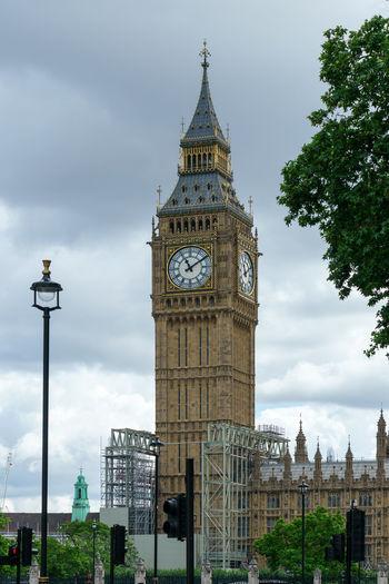 Clock tower against buildings in city