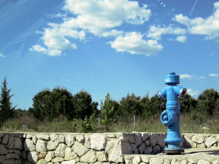 Blue Cloud Cloud - Sky Day Fire Hydrant Green Color Ladyphotographerofthemonth Nature No People Outdoors Simplicity Sky Stone - Object Stone Wall Tranquility Tree Wall - Building Feature Learn & Shoot: Balancing Elements Landscapes With WhiteWall