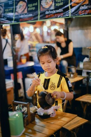 Helping her mum out Business Stories Helper Daughter Serious Night Market Bangkok