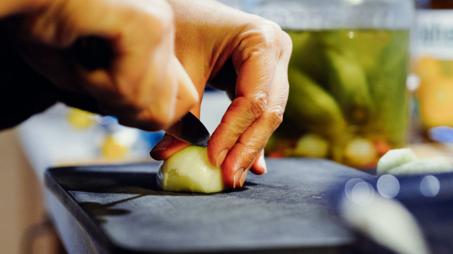 BABY, DON'T CRY Cooking Chopping Close-up Cutting Cutting Board Day Food Food And Drink Freshness Healthy Eating Human Body Part Human Hand Indoors  Kitchen Knife One Person Onion People Preparation  Real People Selective Focus Skill  Vegetable Working