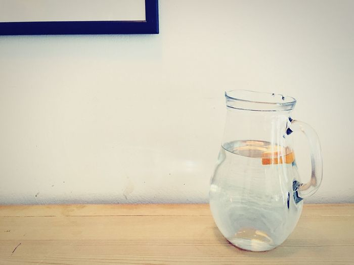 Close-up of water jar on table