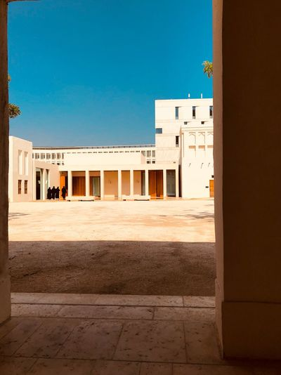 Arabian Moment Built Structure Architecture Building Exterior Sunlight Building Day Sky Real People House Copy Space Sunny Land Outdoors Blue Residential District Clear Sky Incidental People Window City Nature