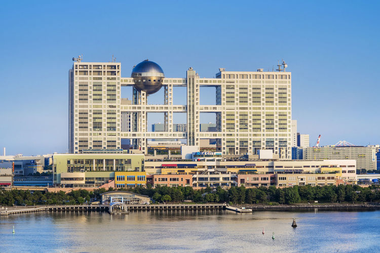 View of the bay of odaiba with daiba park, mall and hotels.