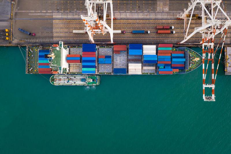 Commercial dock against blue sky at harbor