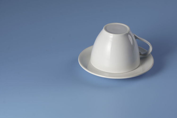 High angle view of white container on table against blue background