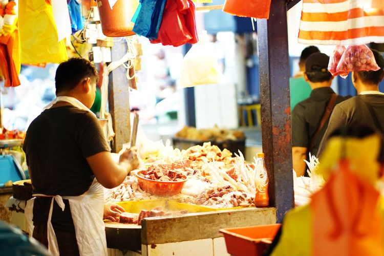 Streetphotography Wetmarket Wetmarketscene Butcher Knife Meat! Meat! Meat! White Meat Working Business Finance And Industry Men Market Food And Drink Casual Clothing For Sale Street Food Stall Display Street Market Retail Display Fish Market