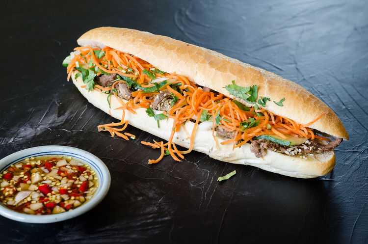 Vietnamese Pork Banh Mi Sandwich with Cilantro and carrot close-up Asian  Baguete Banh Mi Beef Burger Carrot Chili  Cilantro Cilantro Garnish Cocumber Coriander Cuisine Food Fresh Grilled Healthy Herb Meat Pork Sandwitch Sauce Sliced Spicy Traditional Vietnamese