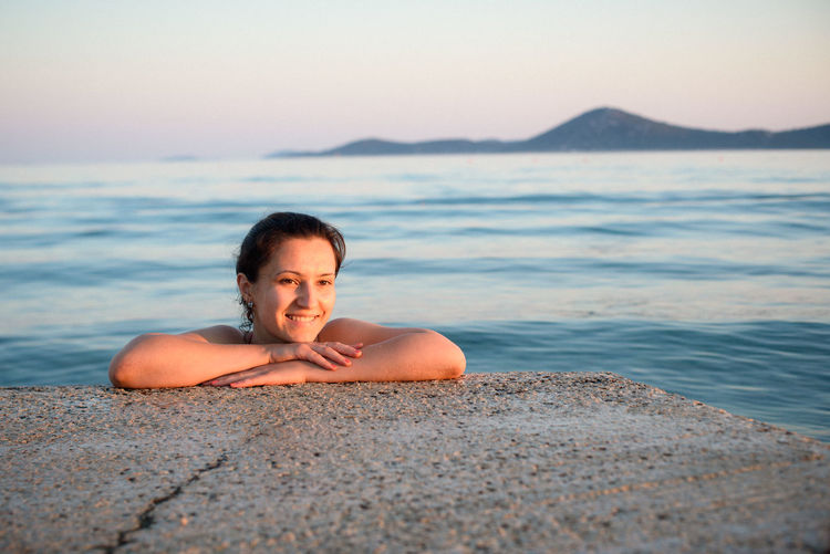 Happy Woman Swimming In Sea