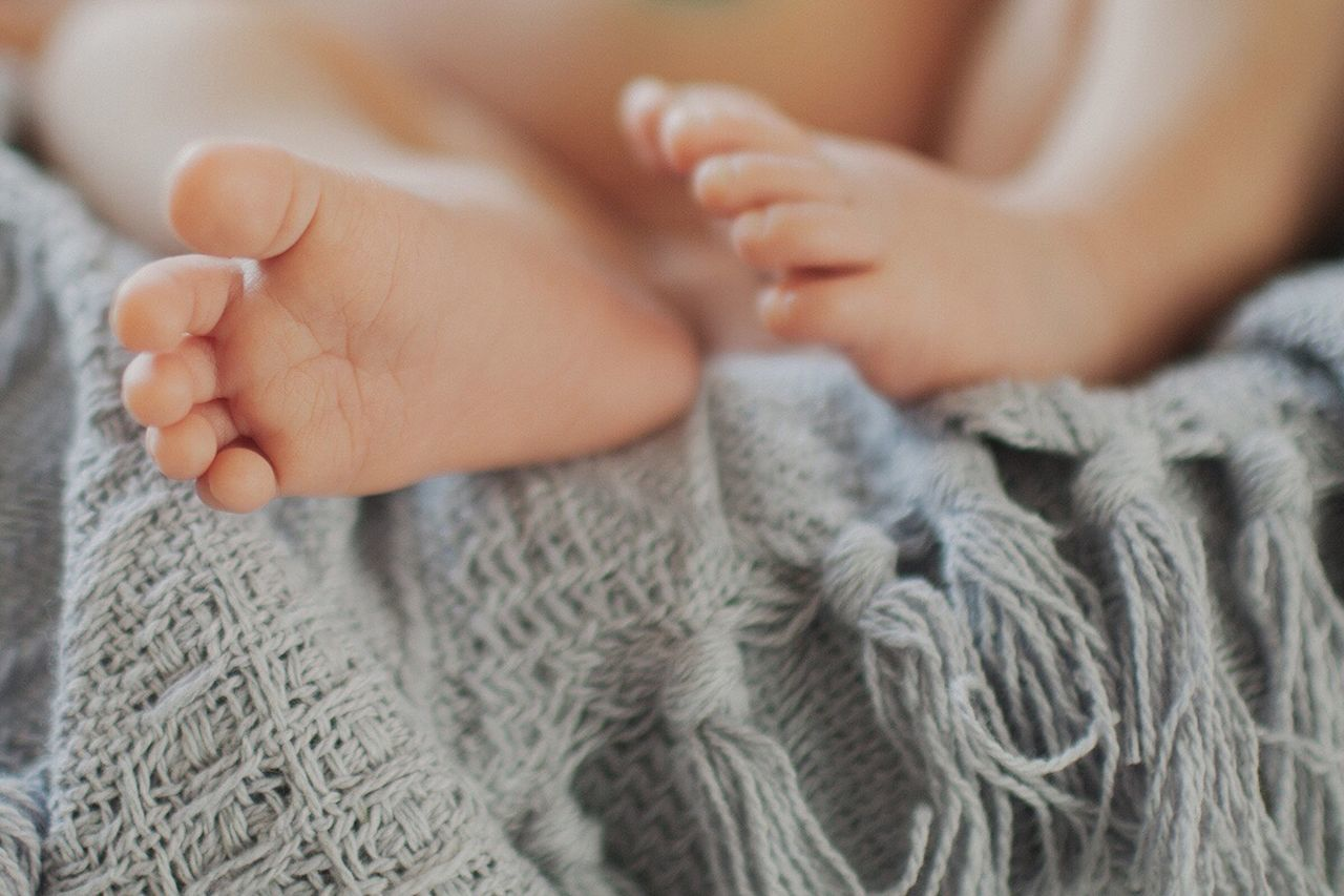 CLOSE-UP OF WOMAN WITH BABY FEET