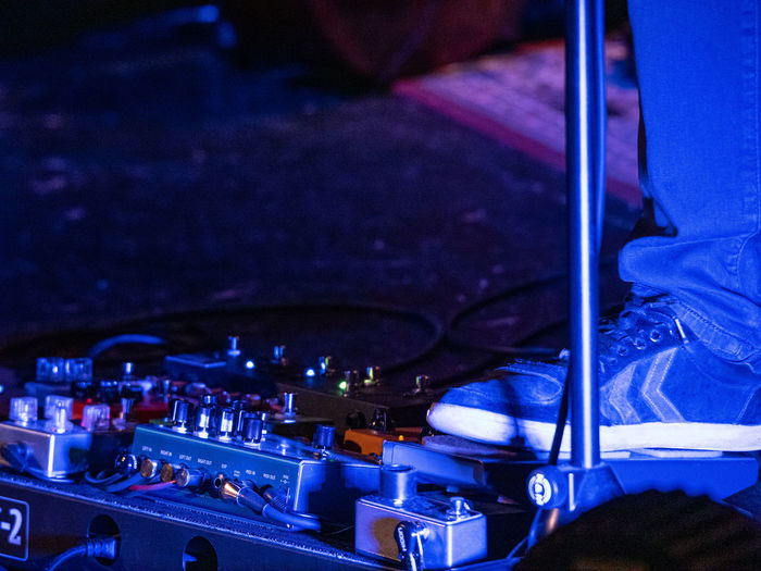 Concert Photography: Jazz Instruments: Guitarist Music Night Illuminated Indoors  Arts Culture And Entertainment Technology Human Body Part Real People One Person Occupation Blue Close-up Equipment Cable Sound Recording Equipment High Angle View Stage Nightlife Rock Music Human Foot