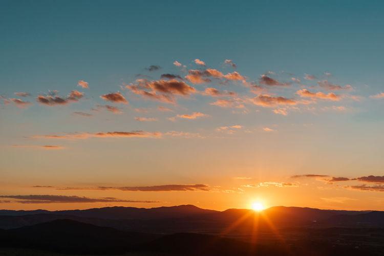Sky Sunset Beauty In Nature Scenics - Nature Tranquil Scene Tranquility Cloud - Sky Orange Color Mountain Idyllic Environment Nature Non-urban Scene Silhouette Sun Landscape Sunlight Mountain Range No People Outdoors Bright Capture Tomorrow